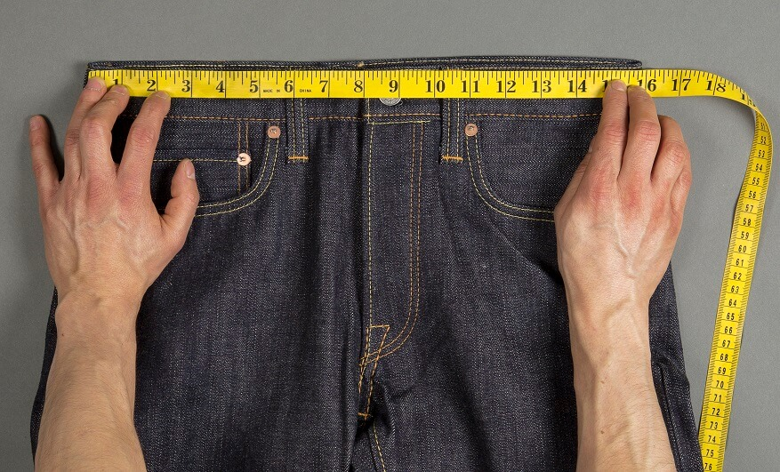 Jean sizes are based on your waist measurement in inches. A soft tape measure, like tailors use, is most accurate. If you don't have one, use a length of twine, then measure that with the tape measure you've got in the garage.
